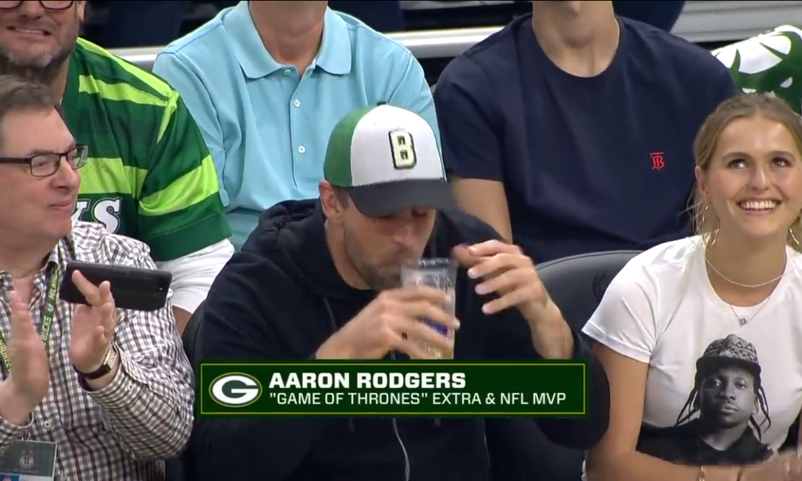 Aaron Rodgers Fails to Chug Full Beer at Bucks Game and Got Roasted For It